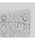 Cojín mezcla tonos crudo y negro con botones
