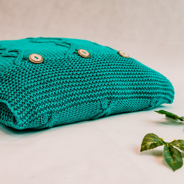 Turquoise square cushion with buttons