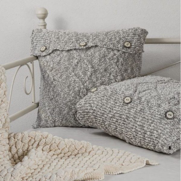Mix of raw white and black shades cushion with buttons