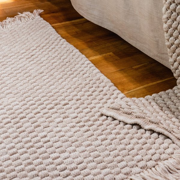 Knitted beige carpet