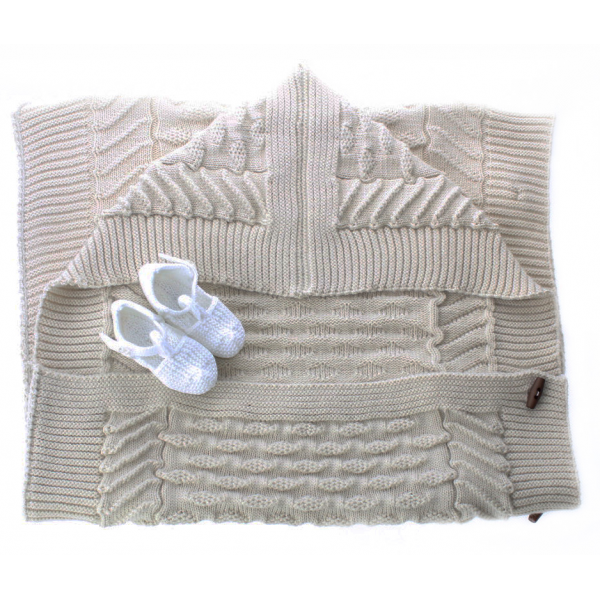 Set of a baby bag and baby shoes
