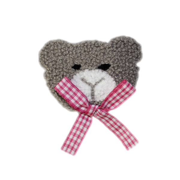 Gray patch with pink ribbon for sewing